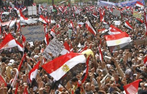 86208-protesters-wave-egyptian-flags-during-a-protest-in-tahrir-square-cairo