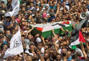 Mourners march in a funeral procession for a Palestinian killed in Israel's air strikes