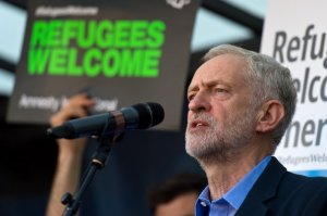 Corbyn's first act after winning was to join a rally supporting refugees