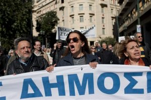 Greek journalist chant anti-austerity slogans during a protest in central Athens, on Wednesday, Feb. 3, 2016. Greek journalists have walked off the job ahead of a general strike set to disrupt services across the country to protest pension reforms that are part of the country's third international bailout. (AP Photo/Petros Giannakouris)